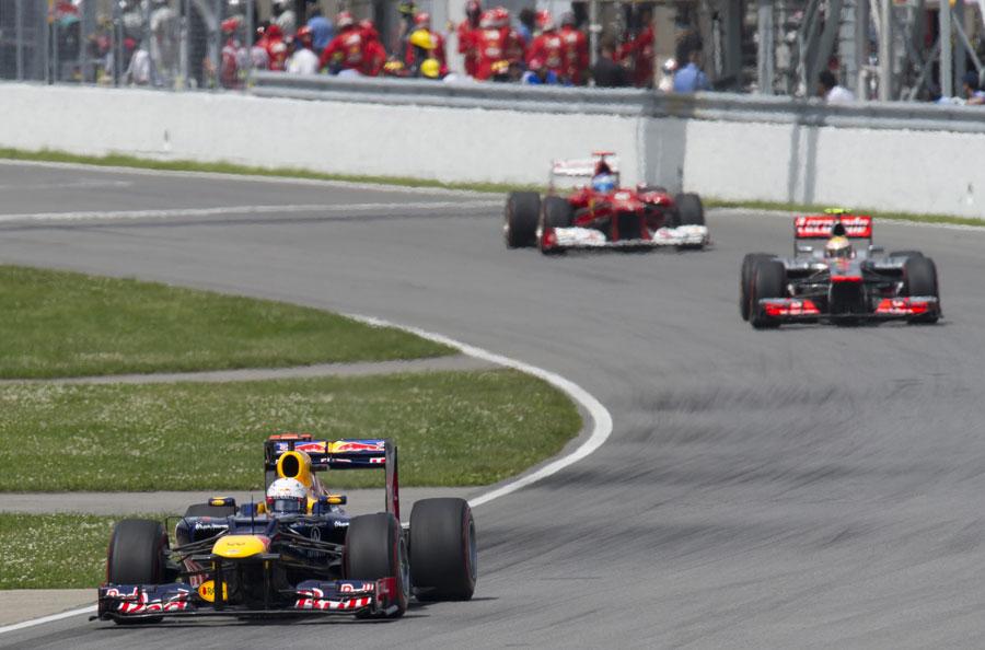 Sebastian Vettel leads Lewis Hamilton and Fernando Alonso