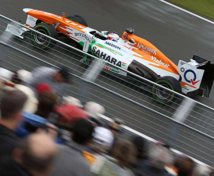 Paul di Resta passes a grandstand of fans