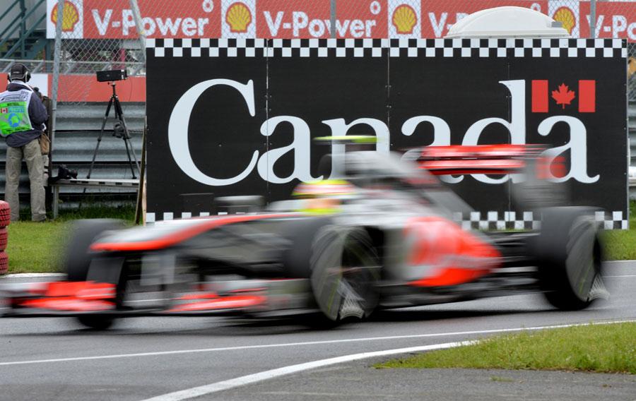 Sergio Perez returns to the pit lane