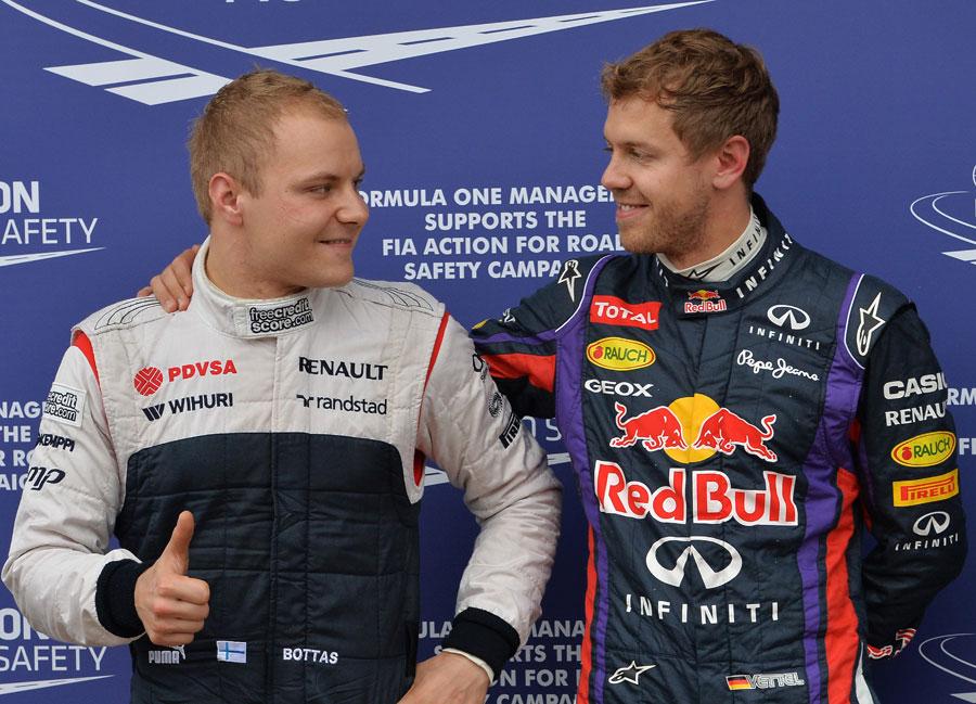 Sebastian Vettel congratulates Valtteri Bottas in parc ferme