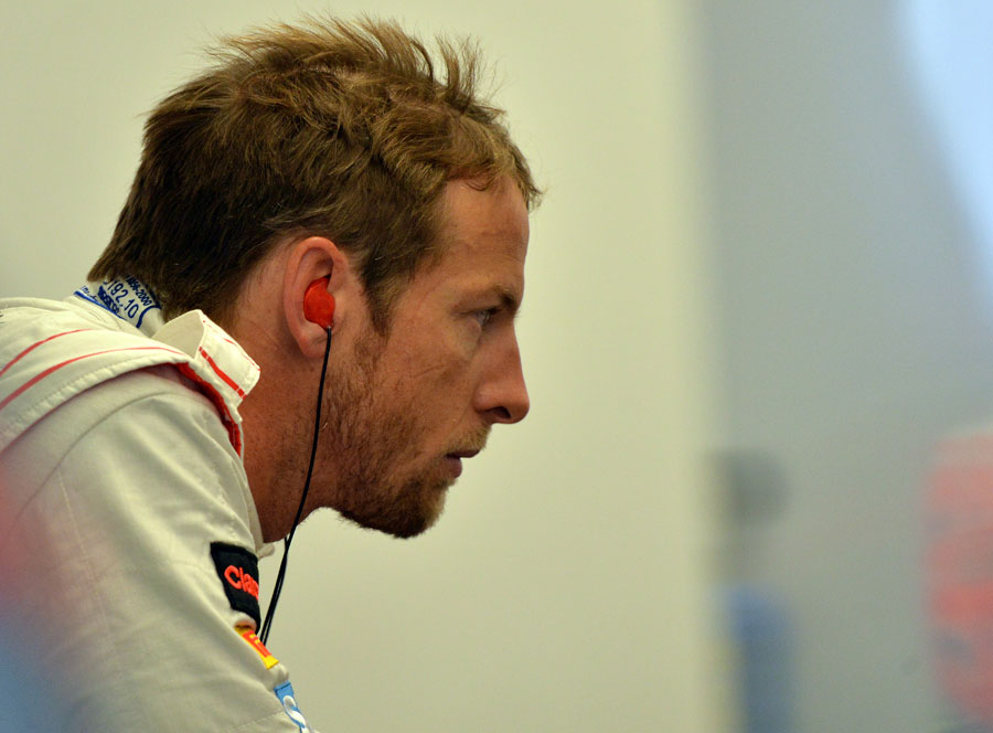 Jenson Button examines his telemetry