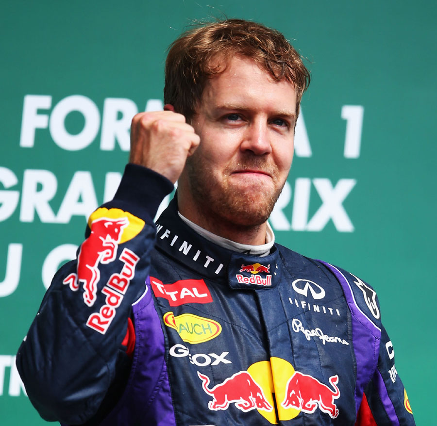 Sebastian Vettel waves to the crowd on the podium