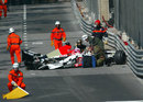 Doctors arrive on the scene to treat Jenson Button after the BAR driver crashed at the Nouvelle Chicane