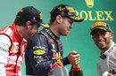 Sebastian Vettel gets soaked in champagne on the podium