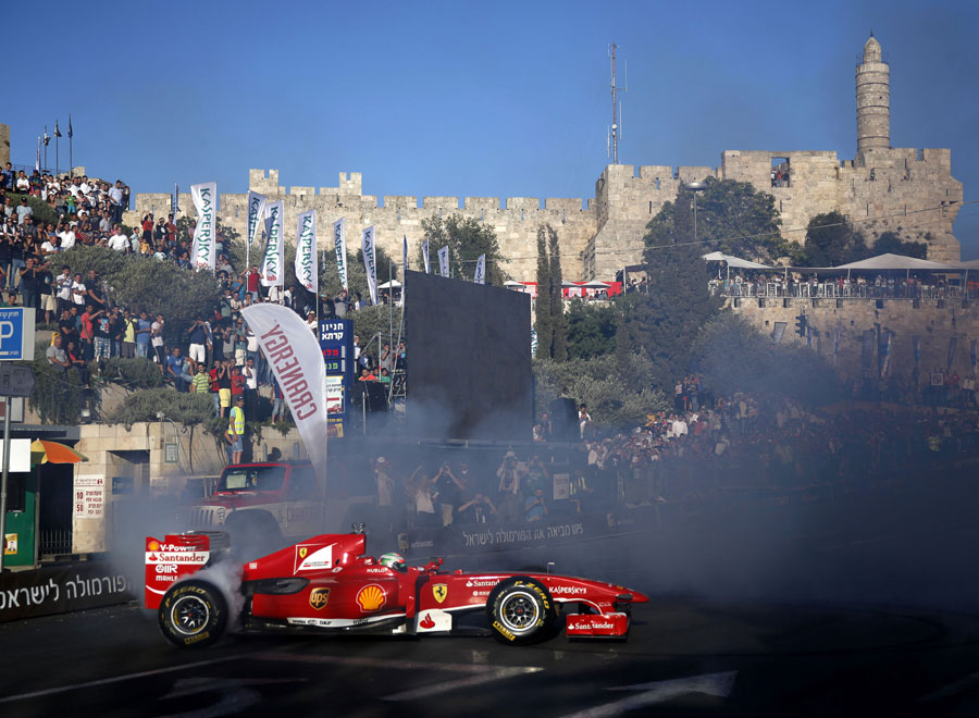 Giancarlo Fisichella demonstrates a Ferrari during the first Jerusalem F1 Peace Roadshow