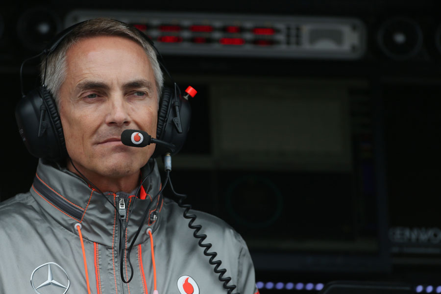 Martin Whitmarsh deep in thought on the McLaren pit wall