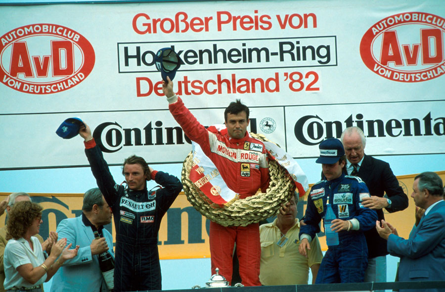 Patrick Tambay celebrates on the podium alongside Rene Arnoux and Keke Rosberg