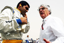Bernie Ecclestone talks to Karun Chandhok