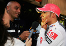 Lewis Hamilton is interviewed by the media after his controversial race finish