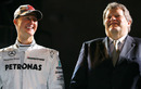 Michael Schumacher and Norbert Haug share a joke
