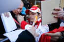 Giancarlo Fisichella signs autographs at the opening of the Ferrari Store in Kiev