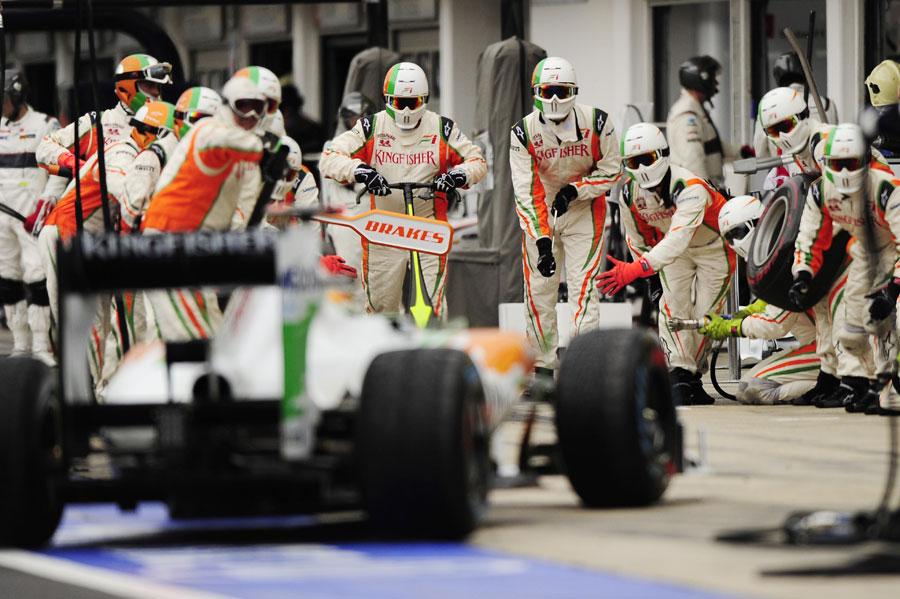Adrian Sutil makes a pit stop