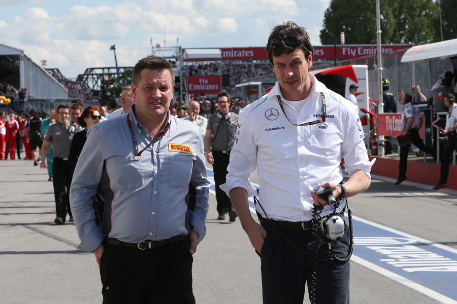 Paul Hembery talks to Toto Wolff in the pit lane