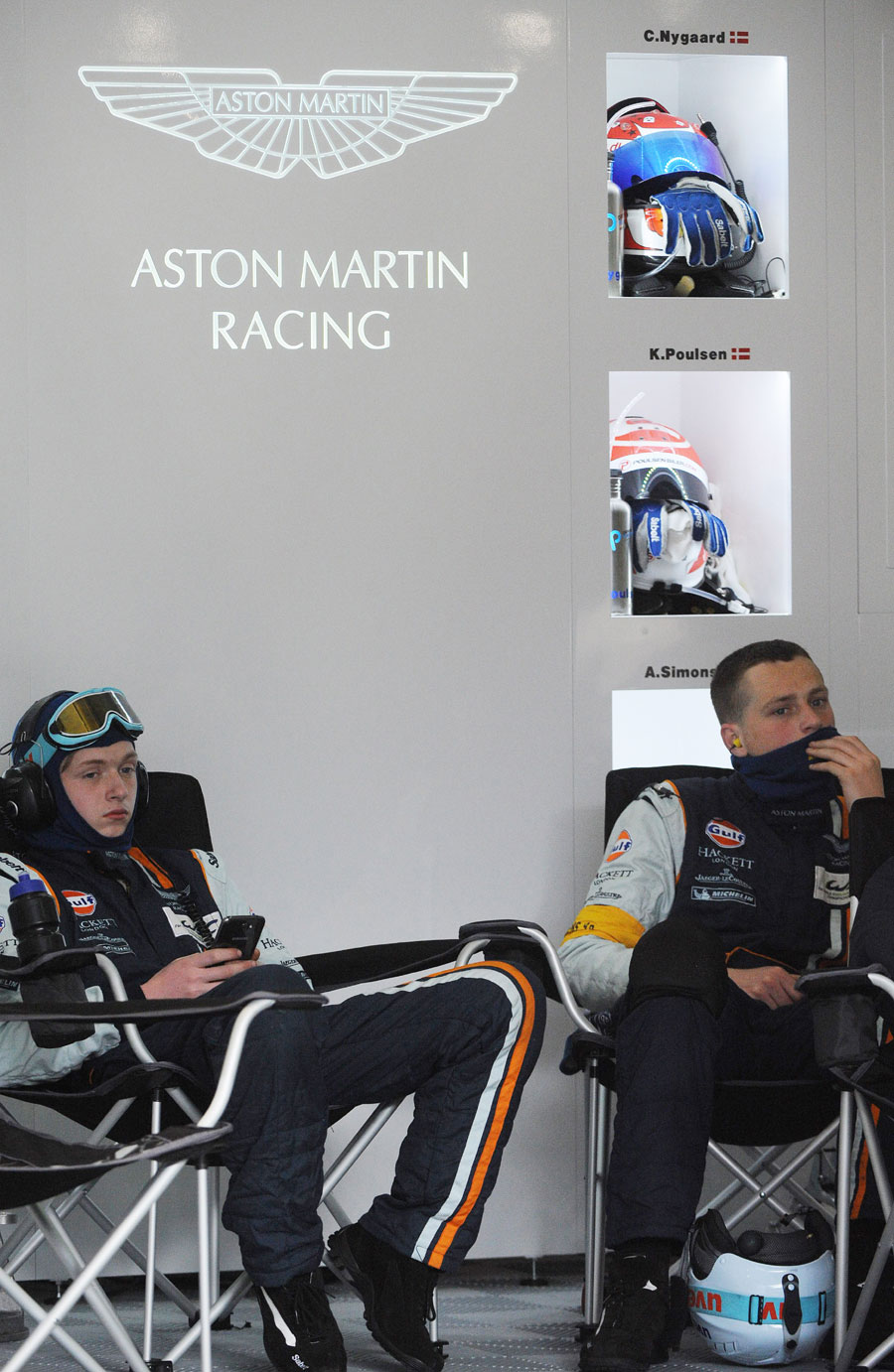 Aston Martin mechanics sit shocked after Allan Simonsen died after crashing into safety barriers