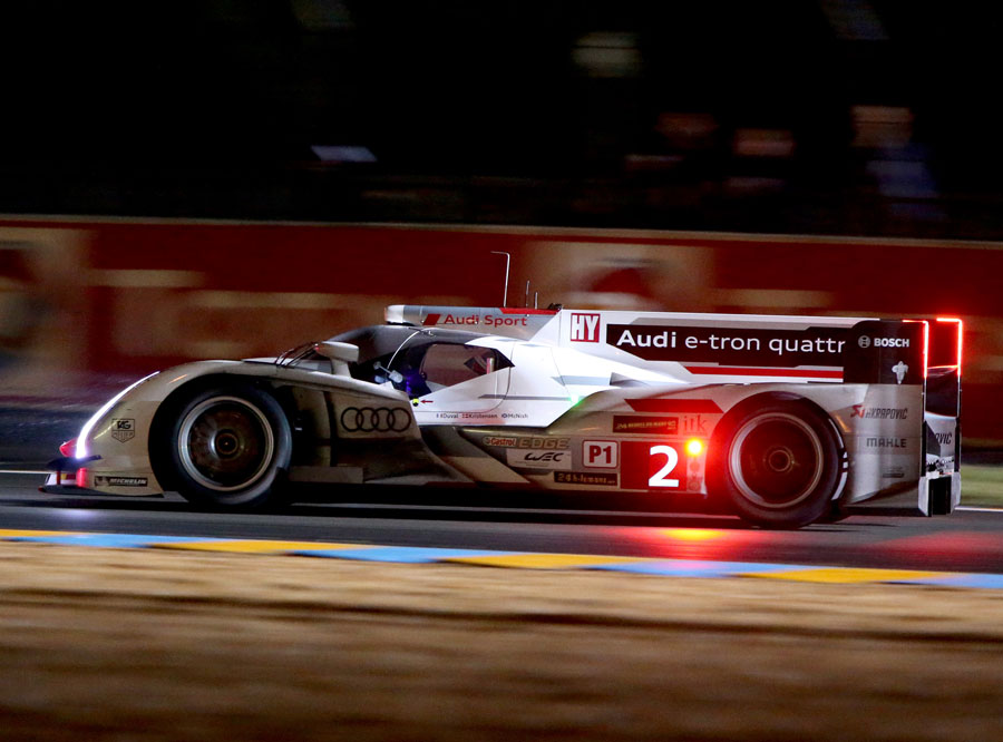 The No.2 Audi of Tom Kristensen, Allan McNish and Loic Duval powers through the night