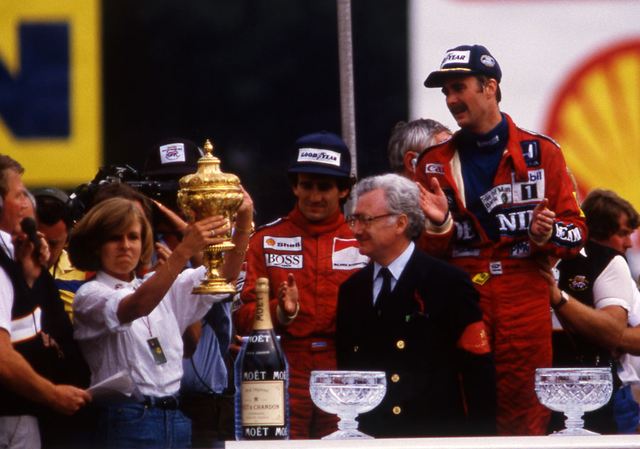 Virginia Williams takes the constructors' trophy on behalf of Frank Williams while he recovered from the accident that paralysed him from the chest down