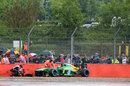 Charles Pic's Caterham lies prone in the wall at the final corner