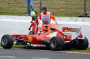 Felipe Massa inspects his damaged Ferrari after another crash