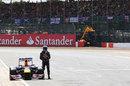 Sebastian Vettel stands by his stricken Red Bull