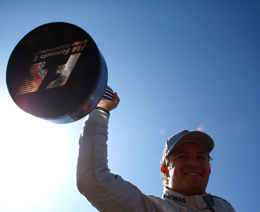 Nico Rosberg celebrates on top of his Mercedes