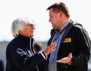 Bernie Ecclestone talks with Paul Hembery in the paddock