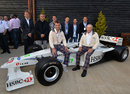 Sir Jackie Stewart and Paul Stewart pose with an SF3 at a Stewart Grand Prix reunion
