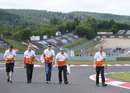 Paul di Resta walks the track with his engineers