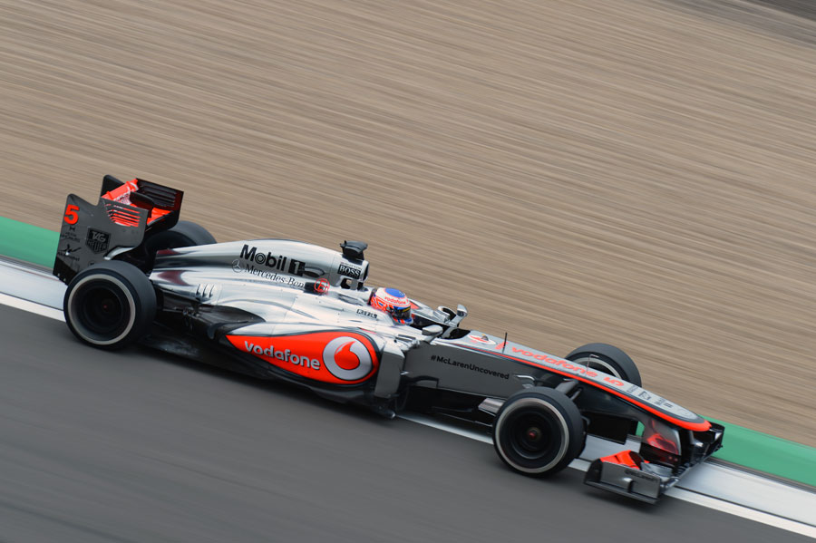 Jenson Button uses all the kerb on the exit