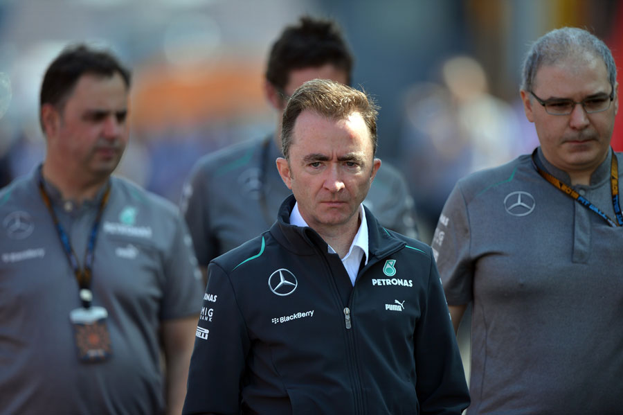 Paddy Lowe arrives at the circuit with Mercedes team members on Saturday morning