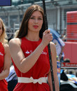 A grid girl ahead of the race