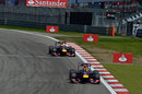 Sebastian Vettel leads Mark Webber early in the race