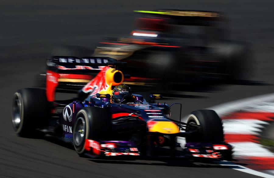 Sebastian Vettel holds off Romain Grosjean