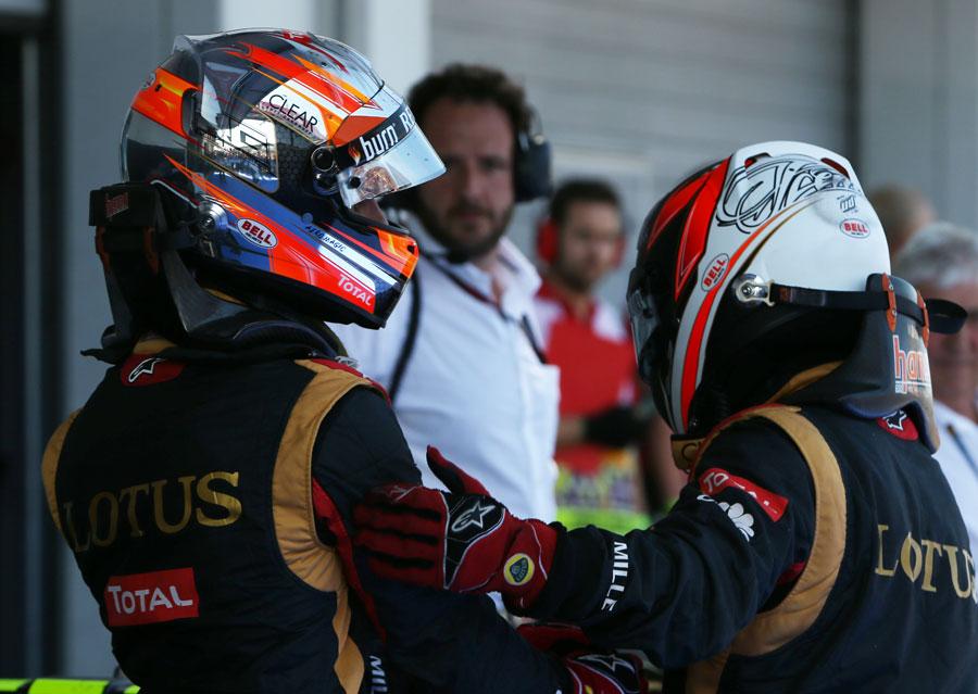Kimi Raikkonen thanks Romain Grosjean in parc ferme