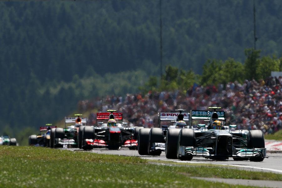 Lewis Hamilton leads a gaggle of cars