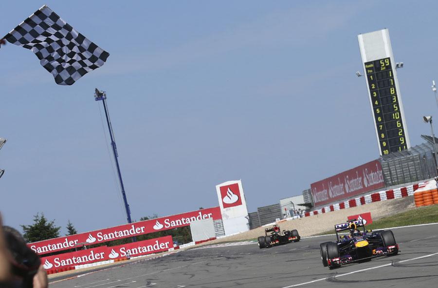 Sebastian Vettel takes victory ahead of Kimi Raikkonen