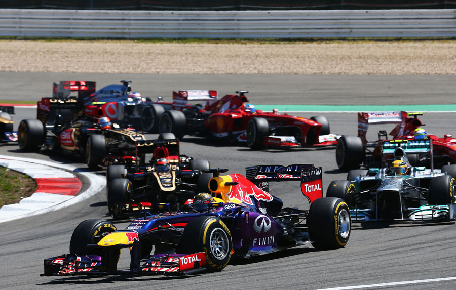 Sebastian Vettel leads the pack through the first corner