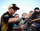 Kimi Raikkonen signs autographs for fans
