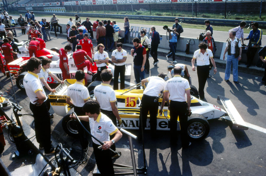 Alain Prost's Renault in a crowded pit lane