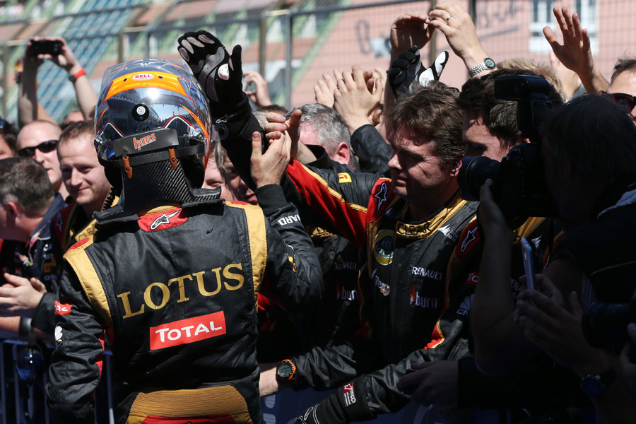 Romain Grosjean celebrates with his team in parc ferme