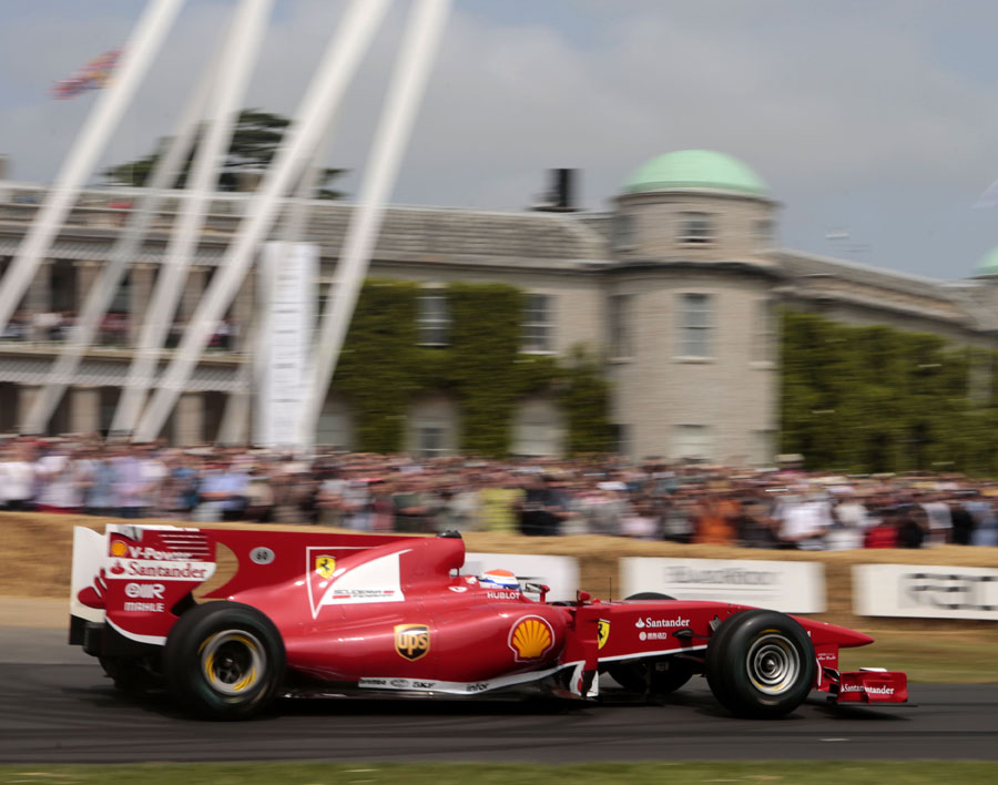 Marc Gene makes his way up the Goodwood hill climb in a Ferrari