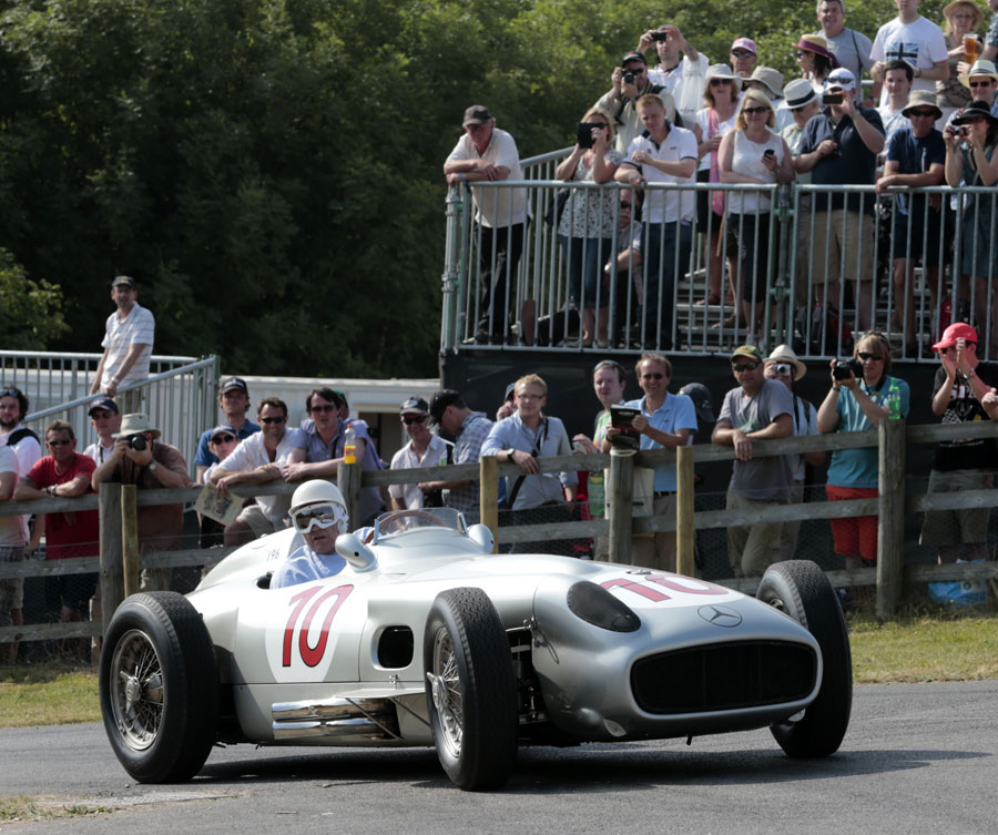 Sir Stirling Moss arrives at the top of the hillcimb in a Mercedes W196