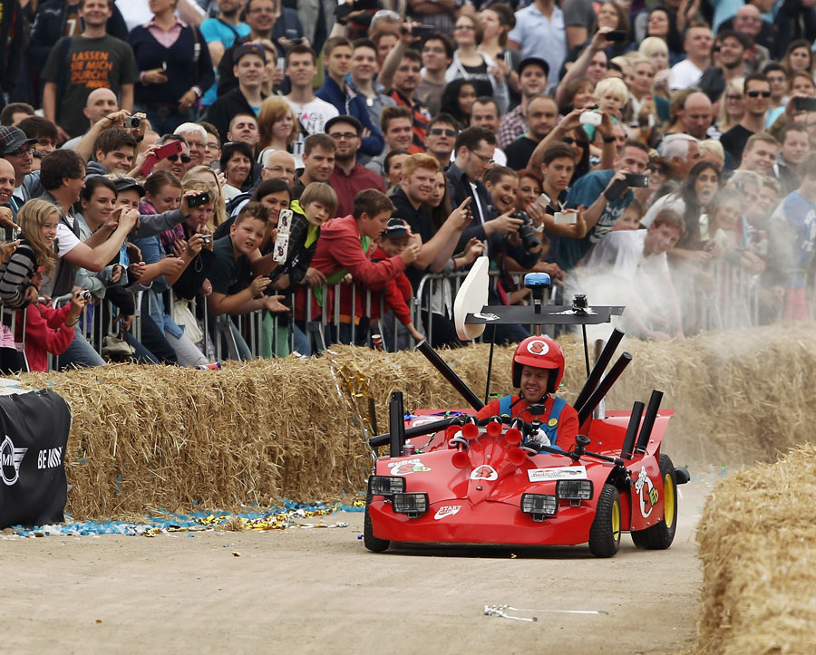 Sebastian Vettel takes part in a soapbox derby event dressed as Super Mario