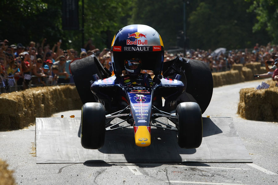 Christian Horner takes part in a soapbox derby event in a vehicle made of old bits of Formula One car