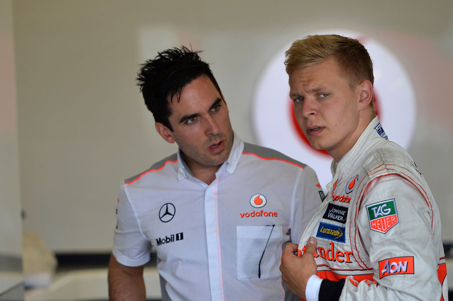Kevin Magnussen talks to his engineer