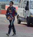 Daniel Ricciardo grimaces as he heads back to the Red Bull garage
