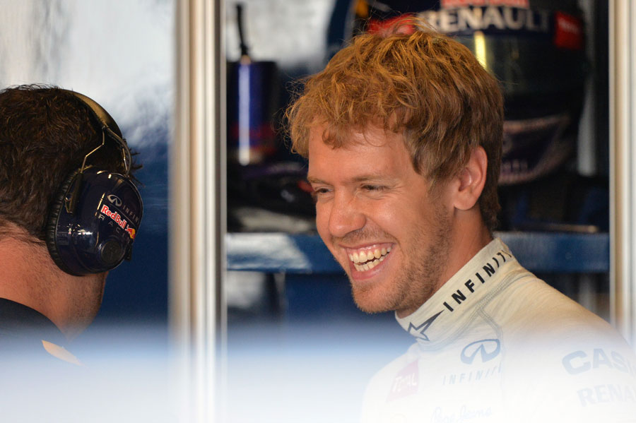 Sebastian Vettel is all smiles in the Red Bull garage