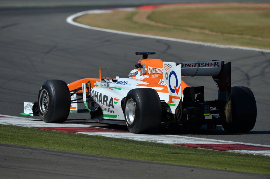 Adrian Sutil gets the power down on prototype tyres