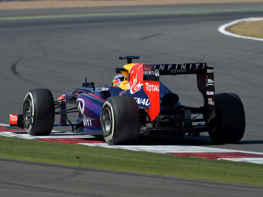 Sebastian Vettel tests medium tyres on his Red Bull