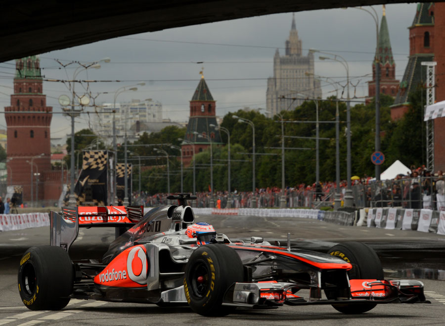 Jenson Button drives in front of the Kremlin during the Moscow City Racing show