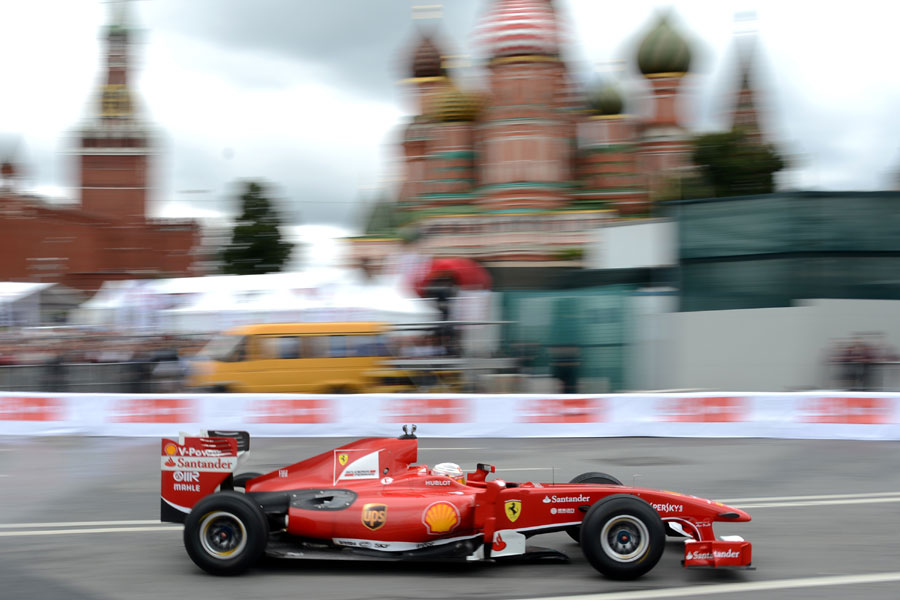 Kamui Kobayashi drives in front of the Kremlin during the Moscow City Racing show